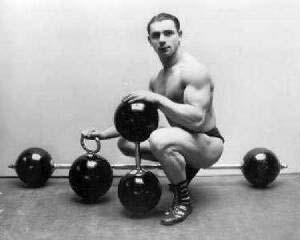 Kettlebell snatch strongman with kettlebells